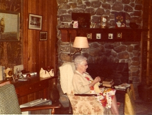 Aunt Florence, knitting.  She was always embarrassed because the wing chair was frayed, so she would drape her sweater over it.